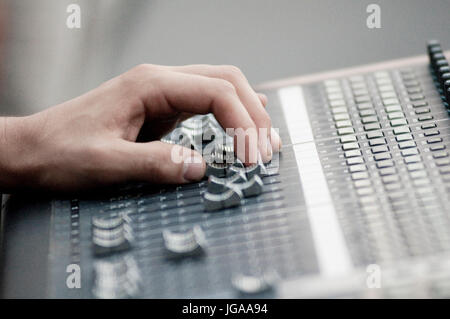 Sound Engineer Operating Professional Sound Mixer at Live Concert, Hand. - Stock Photo