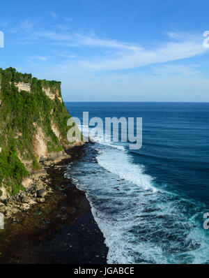 Cliff and sea at Uluwatu temple in Bali island, Indonesia. Uluwatu is the number four surf destination in the world - Stock Photo