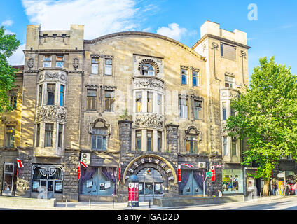 TBILISI, GEORGIA - JUNE 2, 2016: The Art Nouveau edifice with reliefs and sculptures on balconies, located in Rustaveli - Stock Photo