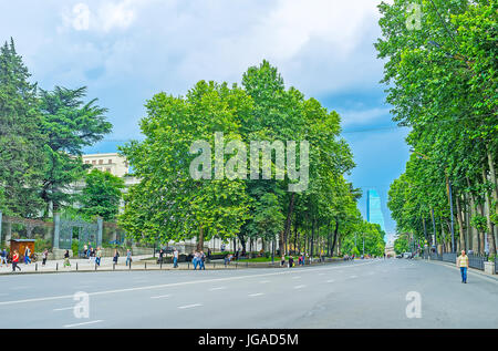 TBILISI, GEORGIA - JUNE 2, 2016: The empty road in Shota Rustaveli Avenue with lush green trees on the both sides, - Stock Photo