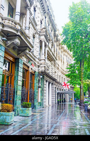 TBILISI, GEORGIA - JUNE 2, 2016: The rainy day in city, Rustaveli Avenue with the shiny wet floor and scenic edifices, - Stock Photo