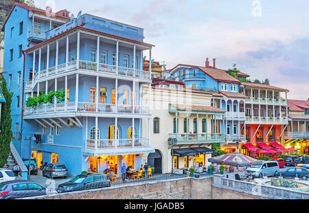 TBILISI, GEORGIA - JUNE 5, 2016: The evening view of the quarters of Abanotubani district, the colorful mansions - Stock Photo