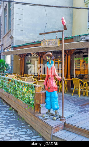 TBILISI, GEORGIA - JUNE 5, 2016: The colorful sculpture of the passenger, waiting forthe konka tram (horsecar) in - Stock Photo