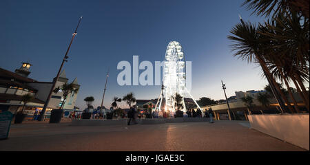 Bournemouth seafront at night on a warm summer's evening - Stock Photo
