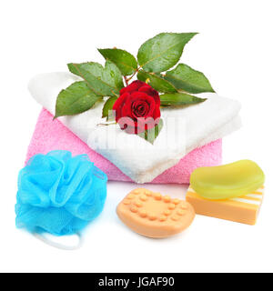 Towels, soap and sponges isolated on white background - Stock Photo