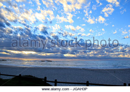 Sunset over the ocean at Camps Bay Beach - Stock Photo