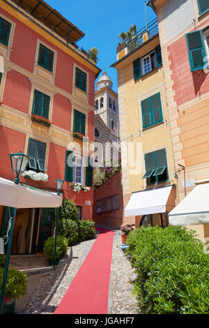 Portofino beautiful village with colorful houses and small street with red carpet in Italy - Stock Photo