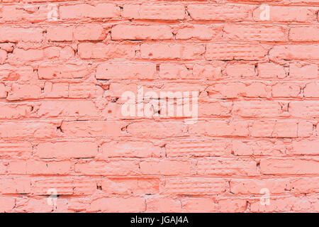 Old painted red brick wall, natural rough gritty texture to the background. For natural design, patterns, background - Stock Photo