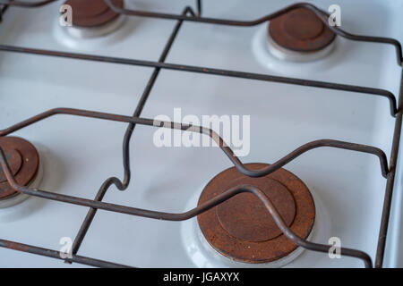 Close up rusty burneres on modern stove - Stock Photo