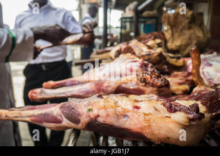 Nyama choma means grilled meat - traditional east african food, Kenya - Stock Photo