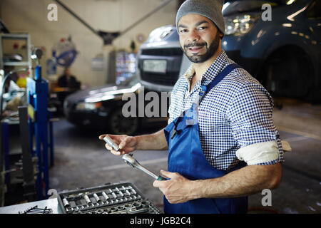 Working in garage - Stock Photo