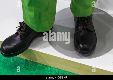 Black Safety Shoe; protective shoe on white floor - Stock Photo