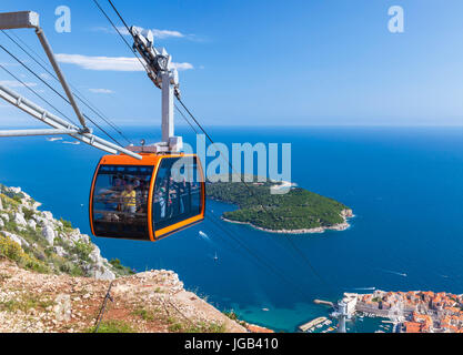 Dubrovnik Croatia Dalmatian coast dubrovnik Tourists in Cable car up Mount Srd Dubrovnik Old Town aerial view Lokrum - Stock Photo