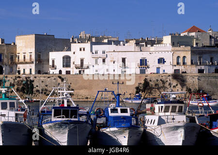 italy, puglia, gallipoli, fishing boats, port and town - Stock Photo