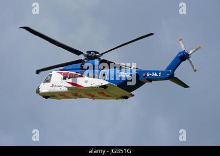 Bristols S92A helicopter on training flight over Inverness airport in Highland Region in the Scottish Highlands. - Stock Photo