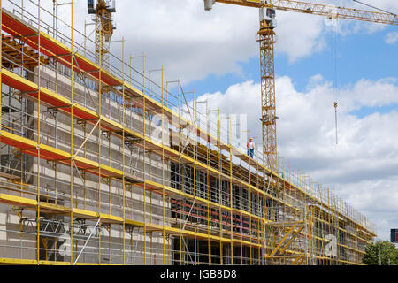 new building construction stite - scaffolding and crane on bulding site - Stock Photo