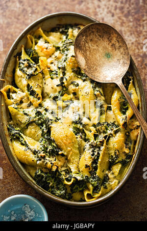 Spinach jumbo seashell pasta with parmesan and blue cheese bake - Stock Photo