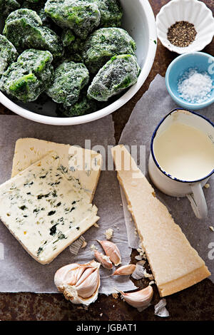 Italian spinach pasta bake ingredients - frozen spinach, cream, parmesan, blue cheese, garlic - Stock Photo