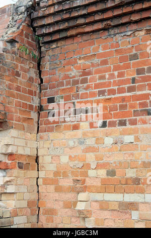 Old Brick Wall Background Close Up View Of Cracked Building With Eroded Bricks On Top