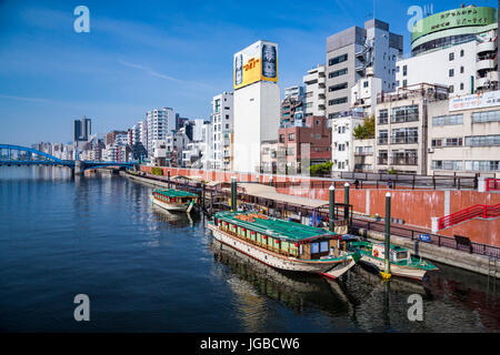 Reflections of boats in the Sumida River in Asakusa, Tokyo, Japan. - Stock Photo