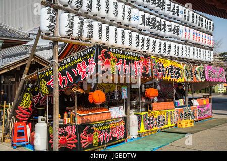An outdoor food kiosk in Asakusa, Tokyo, Japan. - Stock Photo