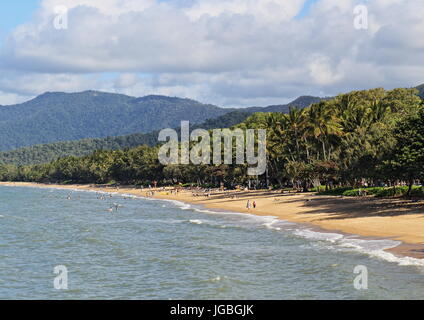 Palm Cove main beach stretch captured from the jetty on a mostly clear winter's day - Stock Photo