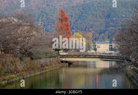 Autumn scenery with a canal in Kyoto, Japan. Kyoto is famous for its numerous classical Buddhist temples, as well - Stock Photo