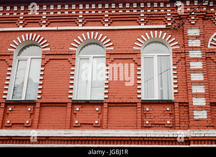 Several windows in a row on facade of urban apartment building front view, St. Petersburg, Russia. - Stock Photo