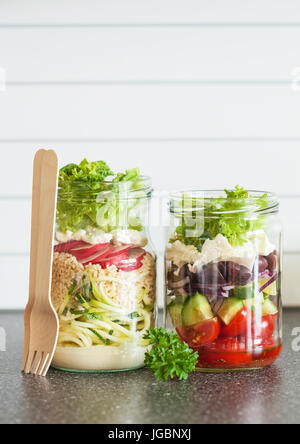 healthy vegetable and cheese salad in mason jars - Stock Photo