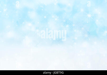 A Winter or Christmas background with appearance of falling snow and stars on a pale blue sky and settled, fallen - Stock Photo