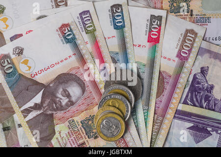Kenyan Shilling Bank Notes And Coins In Various Denominations - Stock Photo