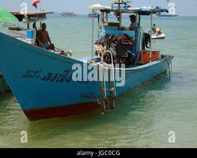 Two Fishing Boats Anchored on the Shoreline in the Gulf of Thailand Pattaya Beach Thailand - Stock Photo