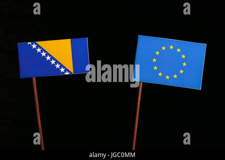 Bosnia and Herzegovina flag with European Union (EU) flag isolated on black background - Stock Photo