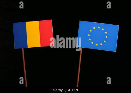 Chad flag with European Union (EU) flag isolated on black background - Stock Photo