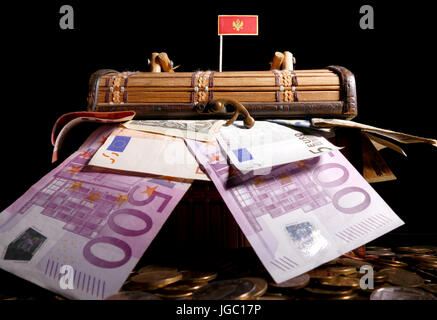 Montenegrin flag on top of crate full of money - Stock Photo