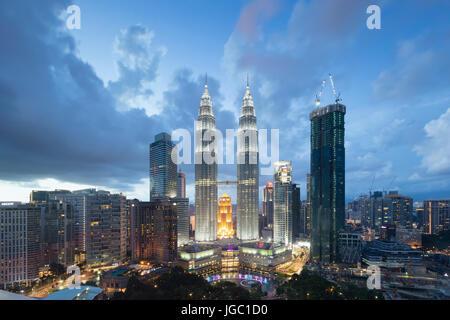 Petronas twin towers at dusk, Kuala Lumpur, Malaysia - Stock Photo