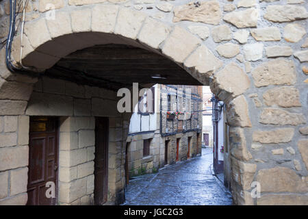 In the centre of Pasajes (Guipuzkoa - Spain), a view of a vaulted passage in the main street lined by pretty houses - Stock Photo