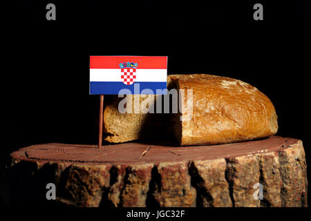 Croatian flag on a stump with bread isolated - Stock Photo