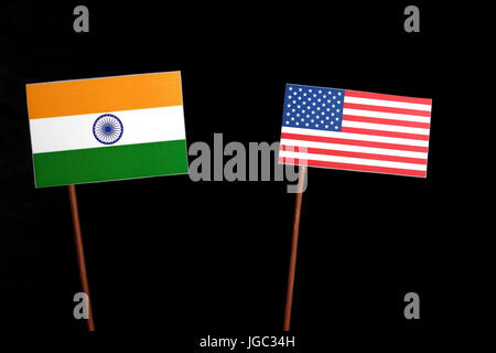 Indian flag with USA flag isolated on black background - Stock Photo