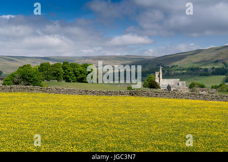 St Margaret, Hawes in the Church of England Diocese of Leeds, from Gayle across a wildflower meadow. North Yorkshire, - Stock Photo