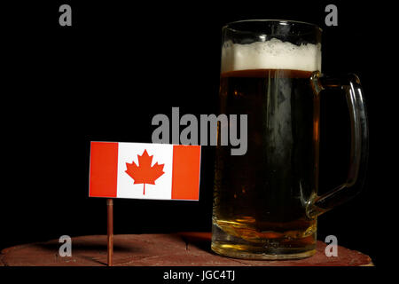 Canadian flag with beer mug isolated on black background - Stock Photo
