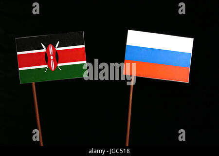 Kenyan flag with Russian flag isolated on black background - Stock Photo