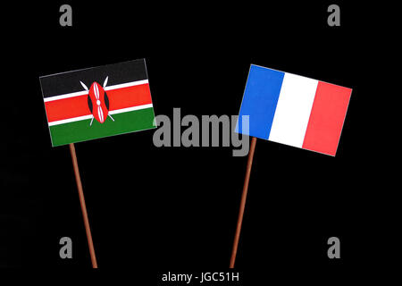 Kenyan flag with French flag isolated on black background - Stock Photo