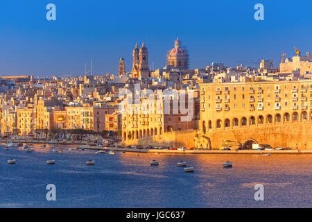 Skyline aerial view of Senglea peninsula as seen from Valletta in the sunny morning, Malta. - Stock Photo