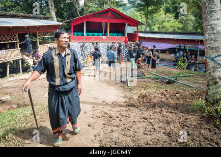 Man at funeral ceremony in Tana Toraja, Sulawesi Indonesia - Stock Photo