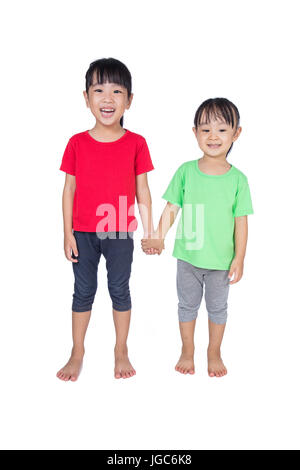 Asian Chinese little girls holding hands in isolated white background - Stock Photo