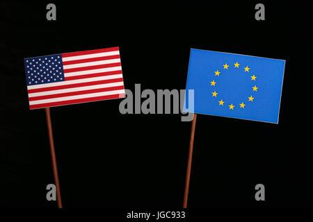 USA flag with European Union (EU) flag isolated on black background - Stock Photo