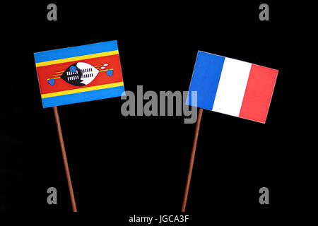 Swaziland flag with French flag isolated on black background - Stock Photo