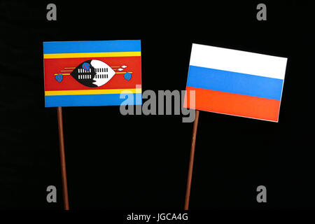 Swaziland flag with Russian flag isolated on black background - Stock Photo