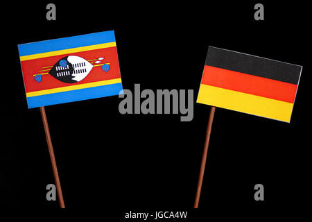 Swaziland flag with German flag isolated on black background - Stock Photo